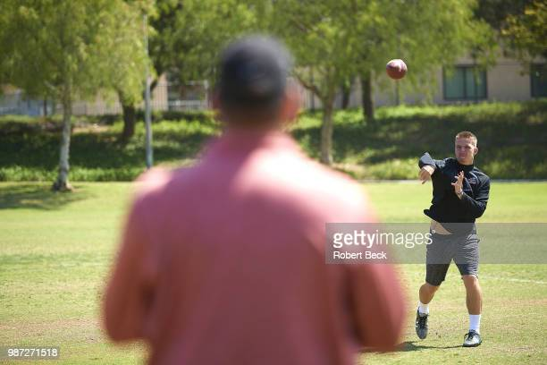 Portrait of Ryan Hilinski brother of former Washington State QB Tyler Hilinski throwing a football during photo shoot at home Doctors discovered...