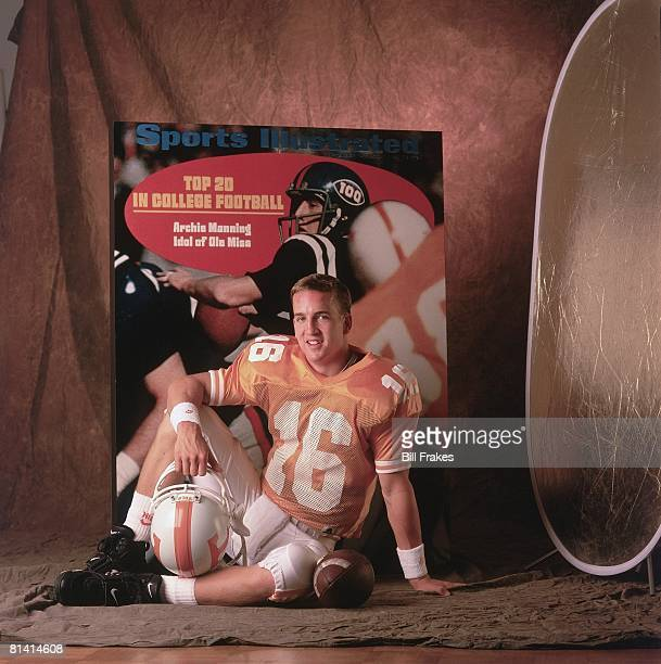 College Football Portrait of Tennessee QB Peyton Manning with SI cover of father Archie Manning from September 14 New Orleans LA 7/11/1996