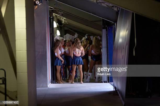Rear view Auburn cheerleaders in runway about to take field before game vs LSU at JordanHare Stadium Auburn AL CREDIT Kevin Liles