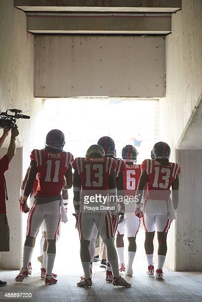 Rear view of Mississippi LMarkell Pack Kailo Moore Jaylen Walton and Eugene Brazley exiting tunnel onto field before game vs TennesseeMartin at...