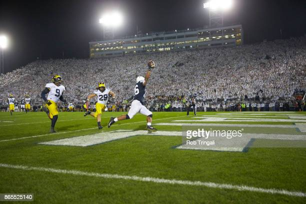 Rear view of Penn State Saquon Barkley victorious scoring touchdown vs at Beaver Stadium State College PA CREDIT Rob Tringali