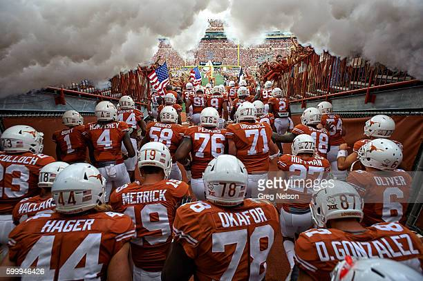 Rear view of Texas players exiting tunnel onto field before game vs Notre Dame at Darrell K RoyalTexas Memorial Stadium Austin TX CREDIT Greg Nelson