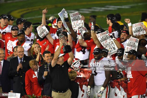 Rose Bowl Georgia coach Kirby Smart victorious holding up The Leishman Trophy after winning game vs Oklahoma at Rose Bowl Stadium Pasadena CA CREDIT...