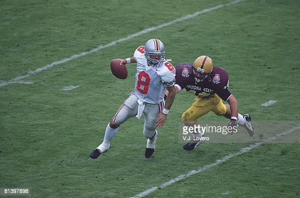 College Football Rose Bowl Ohio State QB Stanley Jackson in action under pressure vs Arizona State Pat Tillman Pasadena CA 1/1/1997