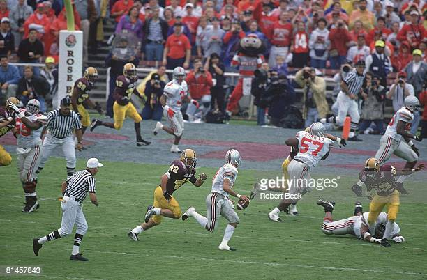 College Football Rose Bowl Ohio State QB Stanley Jackson in action under pressure vs Arizona State Pat Tillman Pasadena CA 1/1/1997