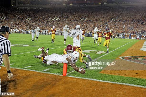 College Football Rose Bowl Texas QB Vince Young in action diving and scoring touchdown during BCS Championship game vs USC Pasadena CA 1/4/2006