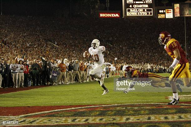 College Football Rose Bowl Texas QB Vince Young in action scoring game winning touchdown in final 19 seconds during BCS Championship game vs USC...