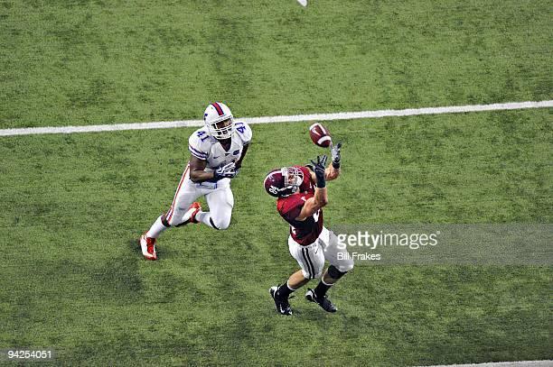 Championship: Alabama Colin Peek in action, making touchdown catch over Florida Ryan Stamper . Cover. Atlanta, GA 12/5/2009 CREDIT: Bill Frakes