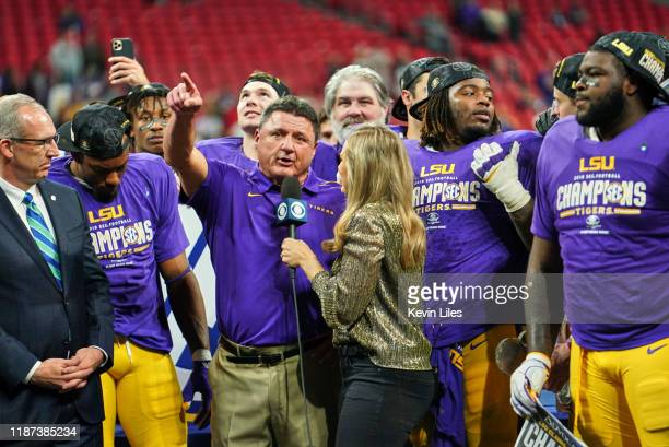 SEC Championship Game LSU coach Ed Orgeron victorious during interview on field with CBS sideline reporter Jamie Erdahl after winning game vs Georgia...