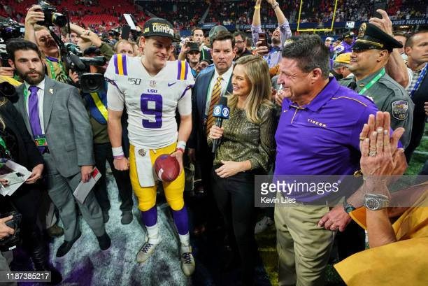 SEC Championship Game LSU QB Joe Burrow and coach Ed Orgeron during interview on field with CBS sideline reporter Jamie Erdahl after winning game vs...