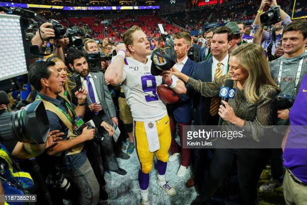 Championship Game: LSU QB Joe Burrow during interview on field with CBS sideline reporter Jamie Erdahl after winning game vs Georgia at Mercedes-Benz...