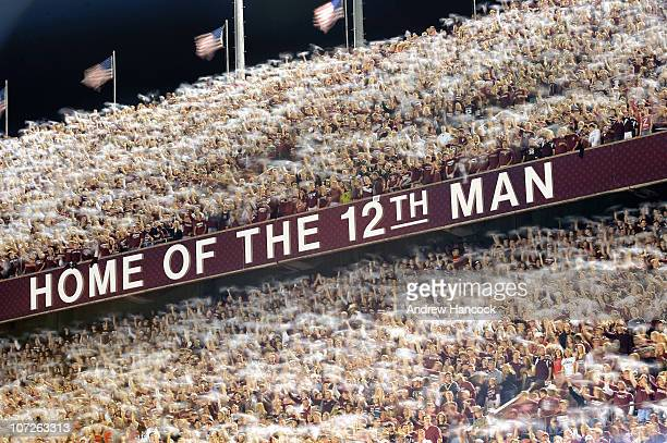 Slow shutter exposure of Texas AM fans waving towels in stands above HOME OF THE 12TH MAN sign during game vs Nebraska at Kyle Field College Station...