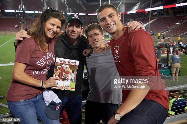 Stanford Chrisitain McCaffrey's mother Lisa father Ed and brothers Dylan and Max in stands after game USC at Stanford Stadium Lisa holding holding...
