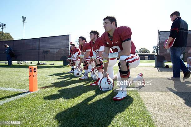 Stanford quarterbacks QB Brett Nottingham QB David Olson QB Robbie Picazo QB Evan Crower and QB Adam Brzeczek kneeling on sidelines during Monday...