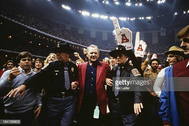 Sugar Bowl Alabama coach Paul Bear Bryant victorious leaving field with police escort after winning National Championship game vs Arkansas at...