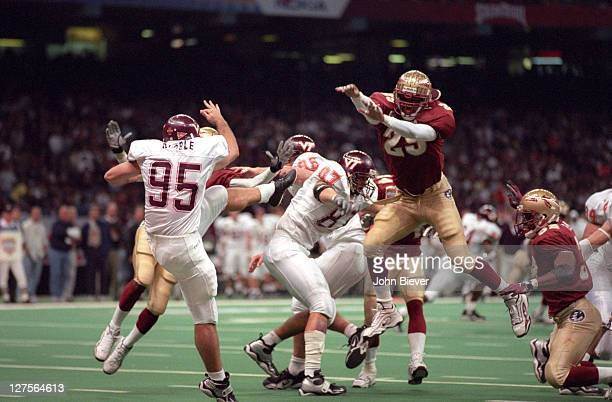 Sugar Bowl Florida State Tommy Polley in action blocking punt vs Virginia Tech Jimmy Kibble at Louisiana Superdome Block led to touchdown New Orleans...