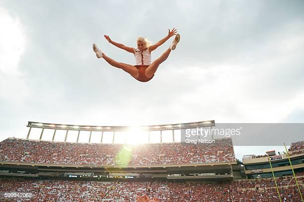 Texas cheerleader in midair during game vs Notre Dame at Darrell K RoyalTexas Memorial Stadium Austin TX CREDIT Greg Nelson