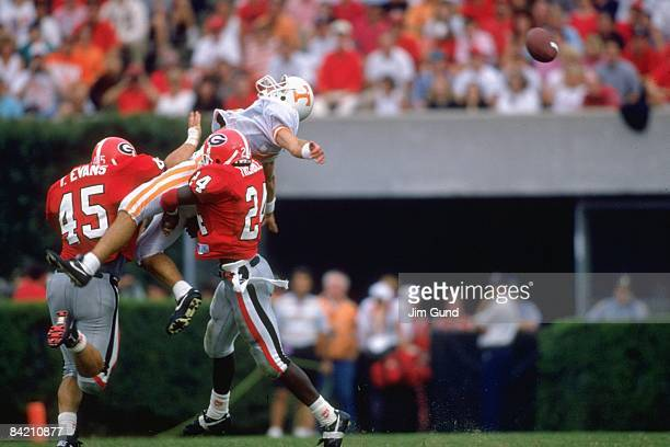University of Tennessee Craig Faulkner in action vs University of Georgia Torrey Evans and Greg Tremble Incomplete pass Athens GA 9/12/1992 CREDIT...