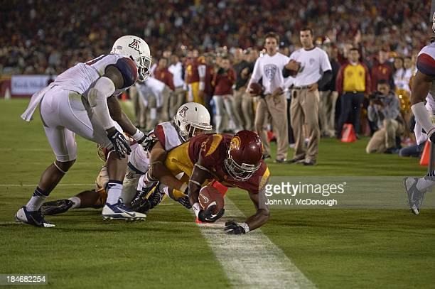 USC Javorius Allen in action vs Arizona Tra'Mayne Bondurant and Jared Tevis at Los Angeles Memorial Coliseum Los Angeles CA CREDIT John W McDonough