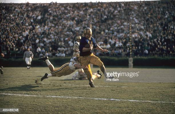 USC Jon Arnett in action rushing vs UCLA Ronnie Knox at Los Angeles Memorial Coliseum Los Angeles CA CREDIT Phil Bath