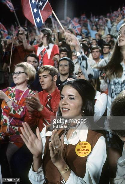 View of Olivia Williams fiancee of Mississippi QB Archie Manning victorious in stands during game vs Alabama at Mississippi Veterans Memorial Stadium...
