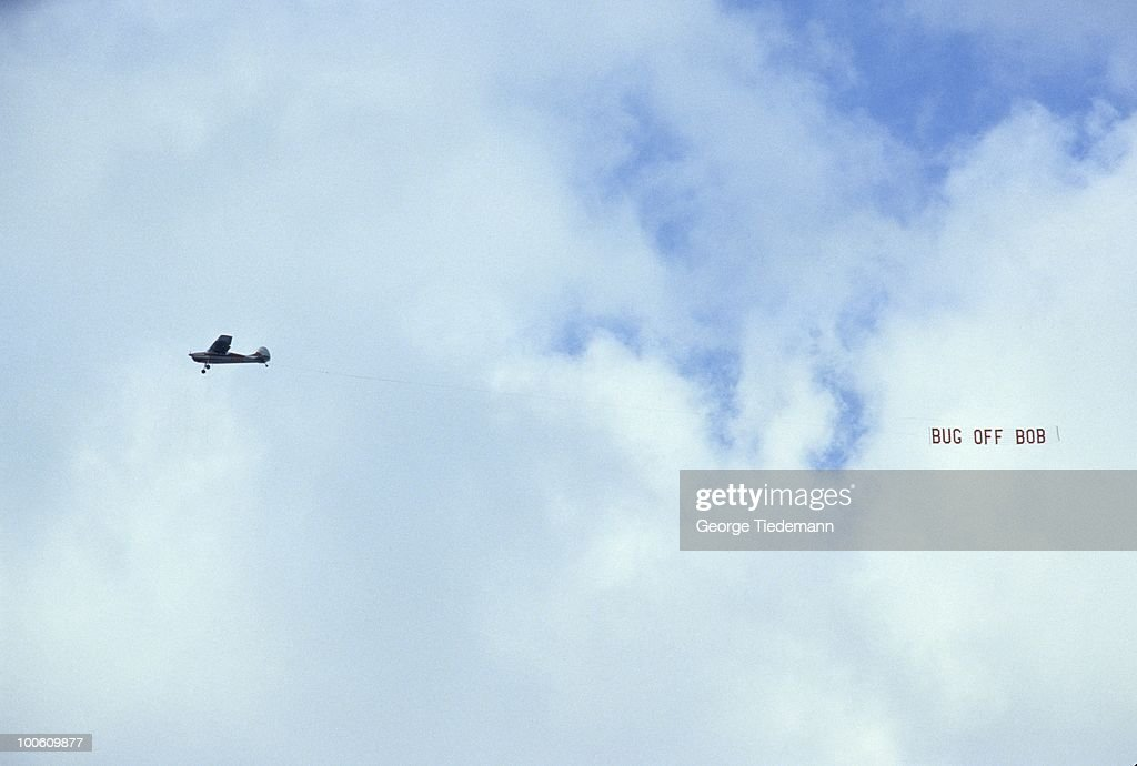 View of plane flying with sign that reads BUG OFF BOB in reference to LSU athletic director Bob Brodhead during LSU vs Alabama game at Tiger Stadium. Baton Rouge, LA