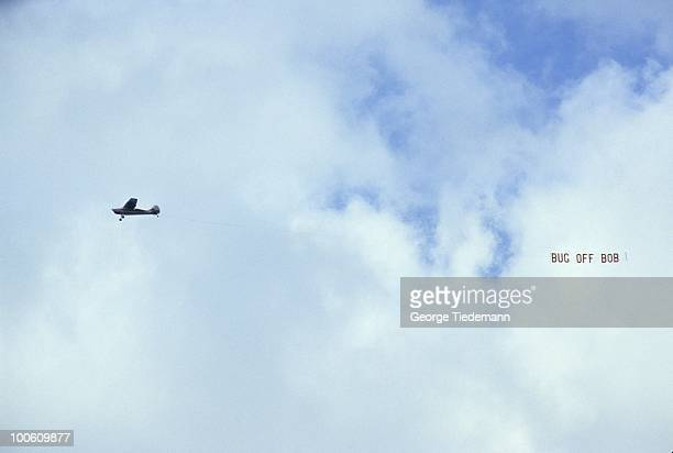 View of plane flying with sign that reads BUG OFF BOB in reference to LSU athletic director Bob Brodhead during LSU vs Alabama game at Tiger Stadium...