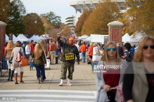 View of ticket scalper with sign that reads TICKET 4 SALE outside JordanHare Stadium before Auburn vs Alabama game Auburn AL CREDIT Kevin Liles