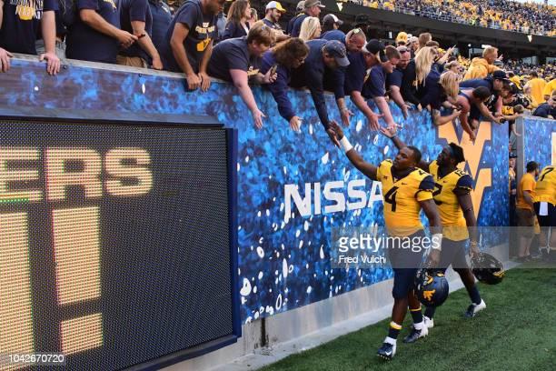 West Virginia Leddie Brown and Gary Jennings Jr greeting fans in stands after game vs Kansas State at Mountaineer Field at Milan Puskar Stadium...