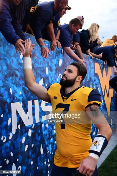 West Virginia QB Will Grier greeting fans in stands after game vs Kansas State at Mountaineer Field at Milan Puskar Stadium Morgantown WV CREDIT Fred...