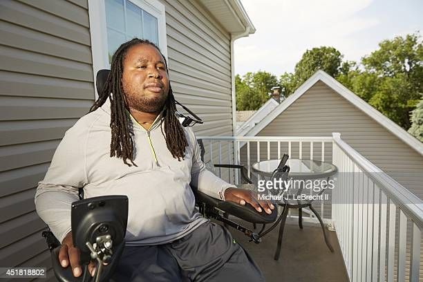 Where Are They Now Portrait of former Rutgers defensive lineman Eric LeGrand in wheelchair during photo shoot outside his home LeGrand who was...