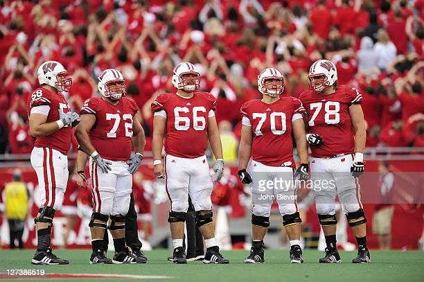 Wisconsin offensive line Ricky Wagner , Travis Frederick , Peter Konz , Kevin Zeitler , and Rob Havenstein on field during game vs South Dakota at...