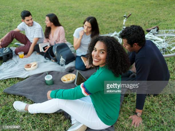 college friends enjoying a day outside - mexican picnic stock pictures, royalty-free photos & images