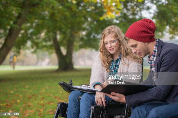 College Friends Study Outdoors On Campus