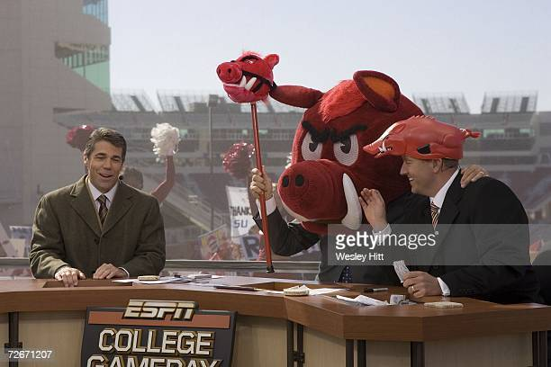 College GameDay Lee Corso puts on the Razorback mascot head in front of Chris Fowler and Kirk Herbstreit on the campus of the Arkansas Razorbacks...