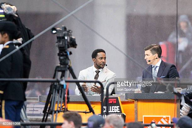College GameDay TV hosts Desmond Howard and Rece Davis chat on set during live filming of ESPN College GameDay before the game between Washington and...