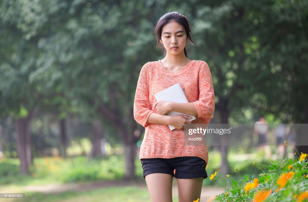 College girl students thinking and walking : Stock Photo