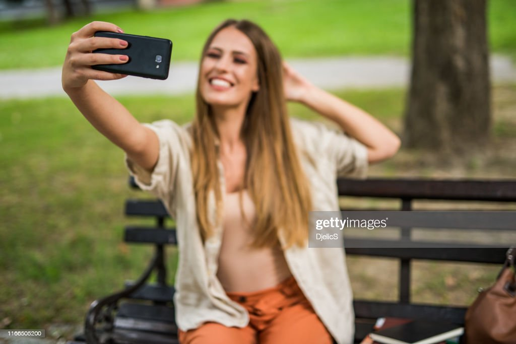 College girl taking a selfie focus on foreground. : Stock Photo