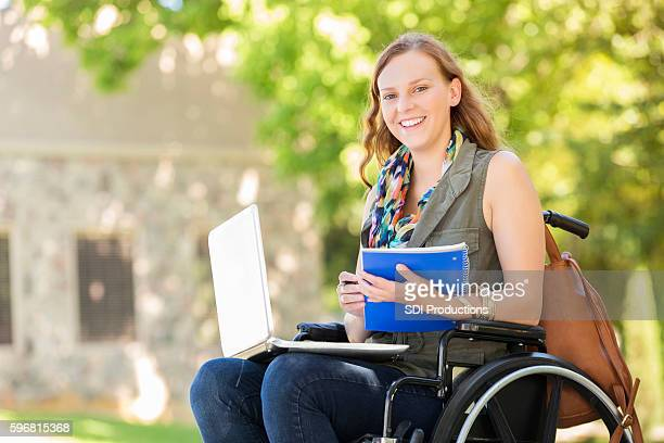 College girl with laptop on campus