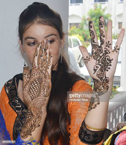 College girls applying mehndi on hands during the celebrations of Teej festival arranged at Khalsa College for Women on August 8 2015 in Amritsar...
