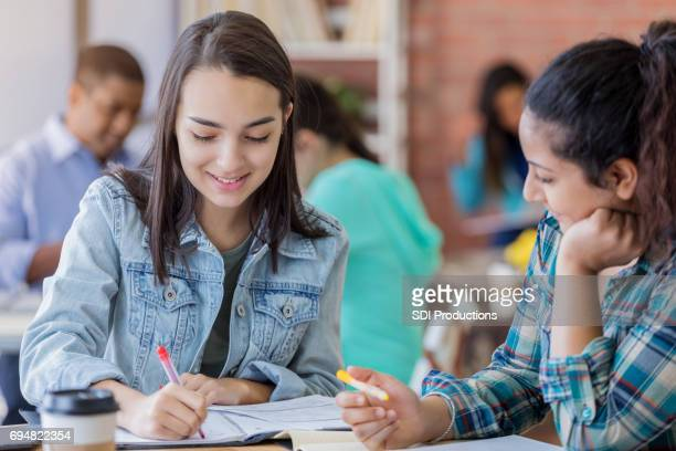 college girls brainstorm together - indian college girls stock photos and pictures