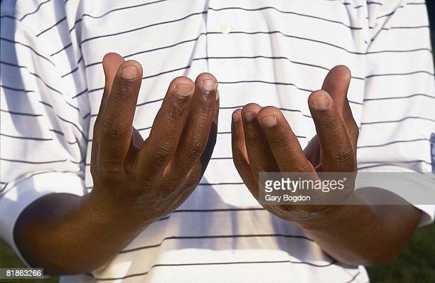 College Golf Closeup portrait of Ohio State Kevin Hall disabled deaf athlete's hands using sign language to convey hitting ball soft at Wild Wing...