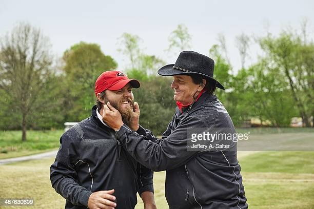 Portrait of Georgia coach Chris Haack posing with player Joey Garber during photo shoot at University of Georgia GC Haack has won 7 SEC championships...