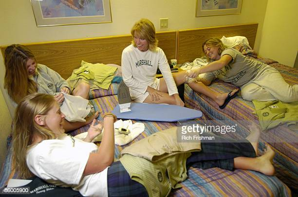 Snowbird Intercollegiate Golf Tournament Portrait of Marshall University Tammy Mahar ironing team clothes with teammates Amber Churchill Carling...