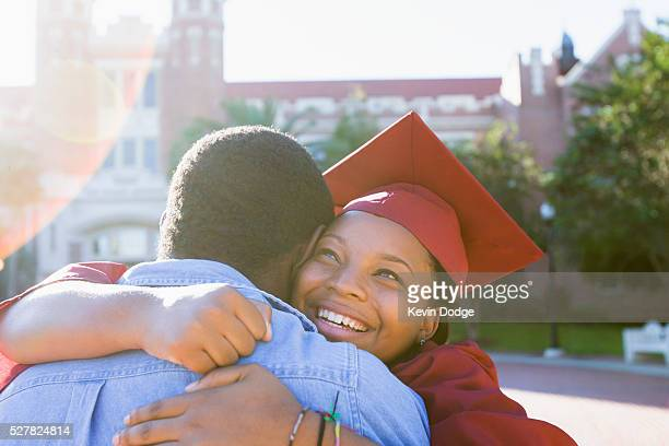 college graduate hugging boyfriend - education stock pictures, royalty-free photos & images