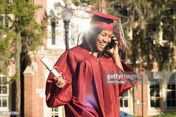 College graduate talking on cell phone