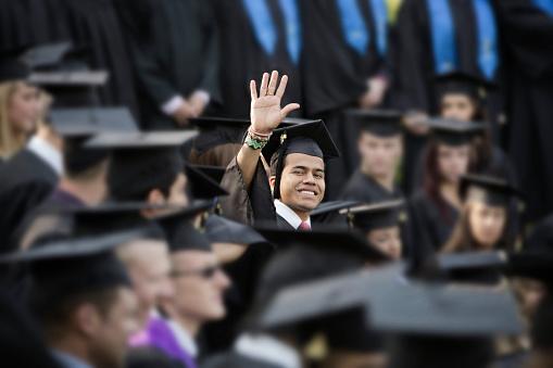 College graduate waving - gettyimageskorea