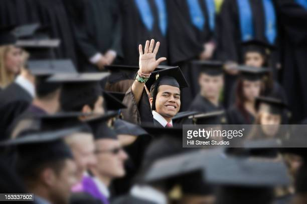 college graduate waving - life events stock pictures, royalty-free photos & images