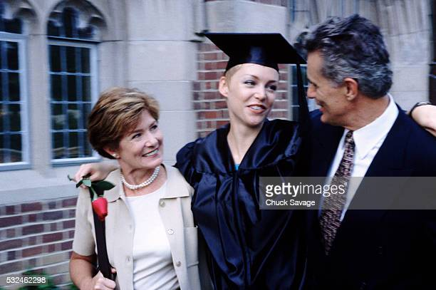 College graduate with her parents