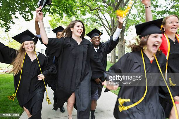 College graduates running and excited